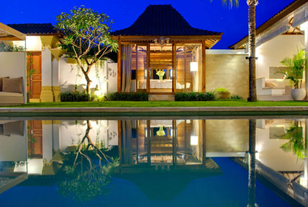 Private Luxury Villa to Rent for your Holidays in Bali, Sahana Villas Seminyak Joglo reflection outdoor pool night view