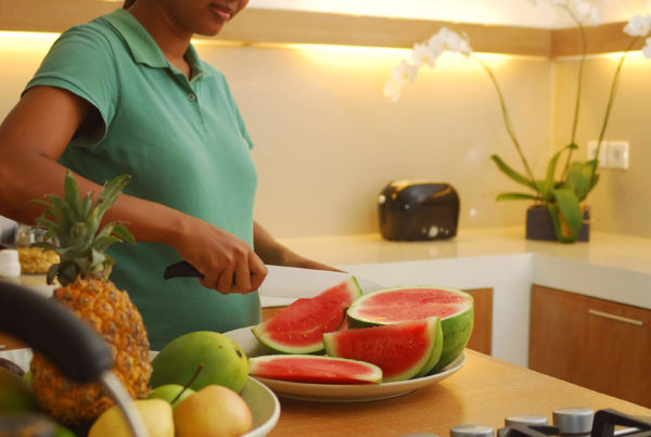 Private luxury villa to Rent for your Holidays in Bali, Sahana Villas Seminyak cooking in the kitchen